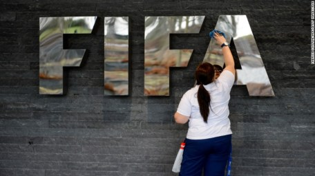 A woman cleans a FIFA sign prior to the arrival of Brazilian President Dilma Rousseff on January 23, 2013 at the football's world governing body's heaquarters in Zurich. Rousseff and FIFA President Sepp Blatter met for updates on the preparations for the 2014 FIFA World Cup in Brazil, taking place from June 12 to July 13. AFP PHOTO / FABRICE COFFRINI        (Photo credit should read FABRICE COFFRINI/AFP/Getty Images)