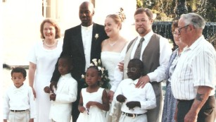 A family photo from Rachel Dolezal's wedding reception on May 21, 2000. According to the Dolezal family, the image shows from left rear, Ruthanne Dolezal, who is Rachel's mother, Rachel's husband, Kevin, Rachel Dolezal, her father Larry Dolezal and her paternal grandparents. In the front row are Larry and Ruthanne Dolezal's adopted children Ezra, Izaiah, Esther and Zachariah.