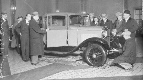 """Ford's updated Model A was introduced to the public in late 1927. The anticipation for the car, designed by a group led by Ford's son Edsel, might be compared to the frenzy surrounding a new Apple product: According to Ford News, <a href=""""http://blog.hemmings.com/index.php/2013/12/02/this-day-in-history-1927-ford-reveals-its-model-a-to-an-eager-public/"""" target=""""_blank"""">more than 10 million people came to look at the car</a> when it went on sale on December 2, 1927. It was still attracting attention in January 1930, when these men came to look one over in Chicago."""