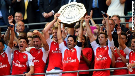 Arsenal captain Mikel Arteta lifts the first silverware of the English domestic season.