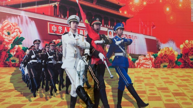 "Liu found this blown-up photo depicting China's prosperity and might, on a billboard in the center of the city. ""I am trying to dive much deeper into the issues of human development,"" Liu says, of his evolving body of work.<br />"