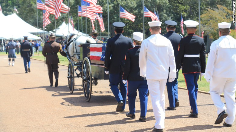 The procession with a caisson bearing a ceremonial casket arrives for Andersonville service.