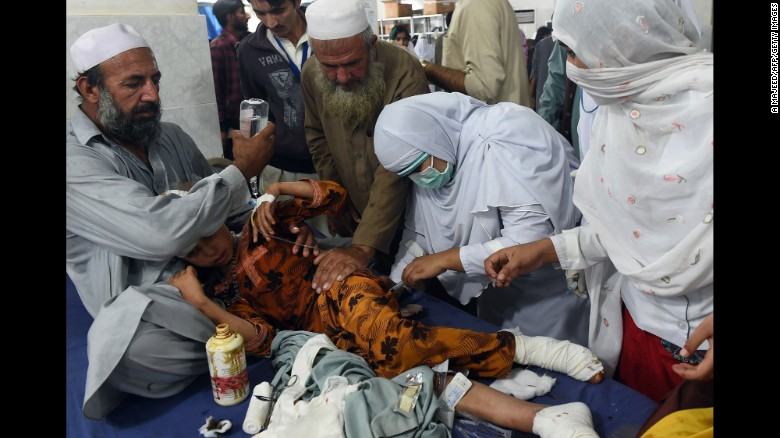 Paramedics treat an injured girl at a hospital in Peshawar, Pakistan, on Monday, October 26. A magnitude-7.5 earthquake struck near Jarm, Afghanistan, along the Afghanistan-Pakistan border.