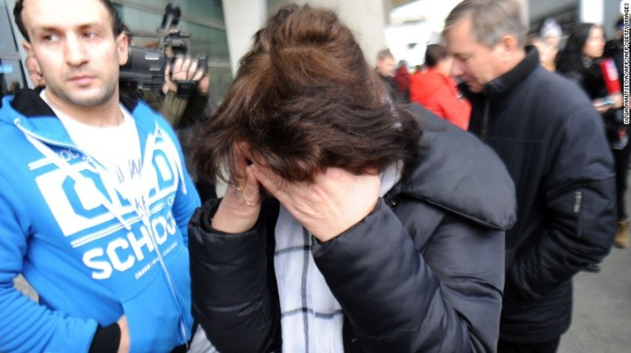Relatives react at the St. Petersburg, Russia, airport after news of the crash.