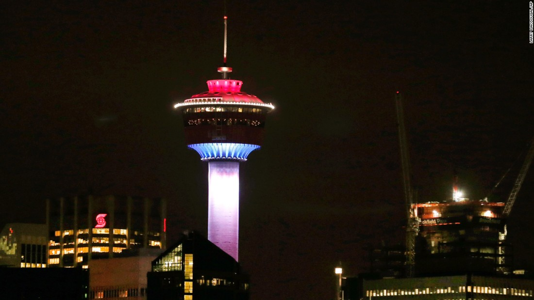 The Calgary Tower in Alberta, Canada, is lit up with the colors of the French flag to show support and sympathy for victims of the Paris attacks.