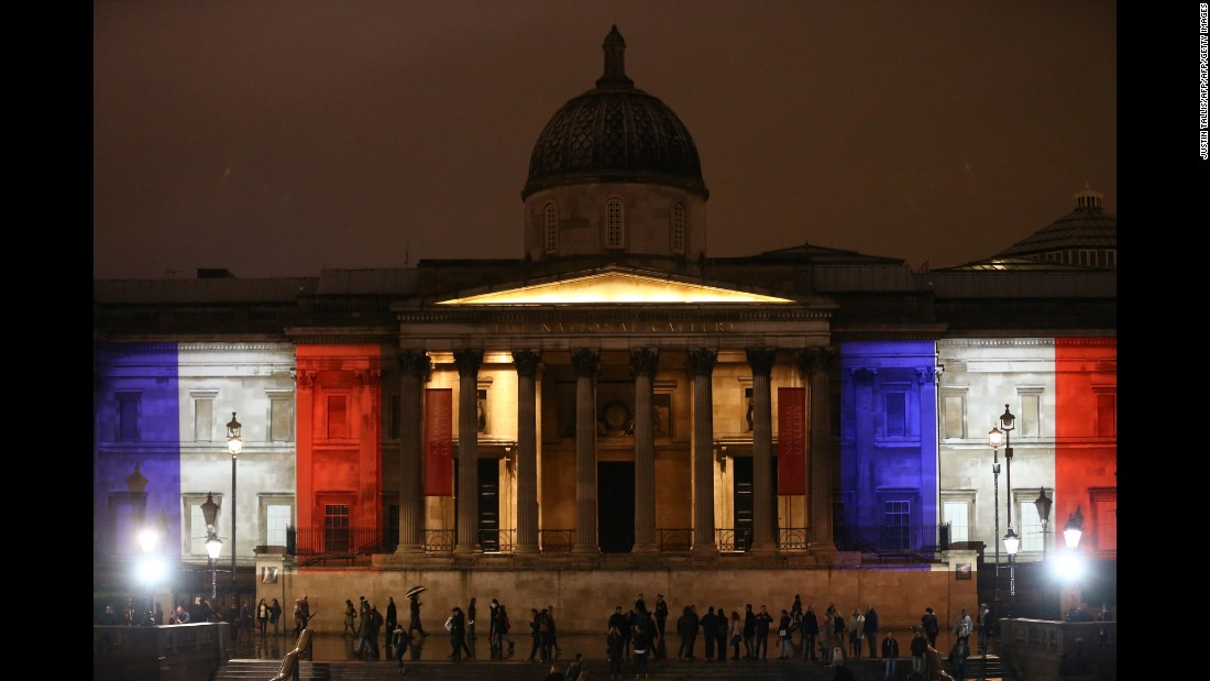 London's National Gallery is illuminated in blue, white and red lights, on November 14.