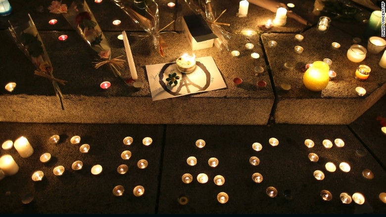 "Candles read ""peace"" at a temporary memorial for the victims of the Paris attacks."