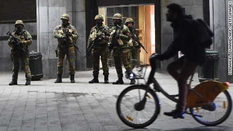 Soldiers stand guard in front of the Brussels Central Train Station on Sunday as the Belgian capital remained on the highest security alert level over fears of a Paris-style attack.