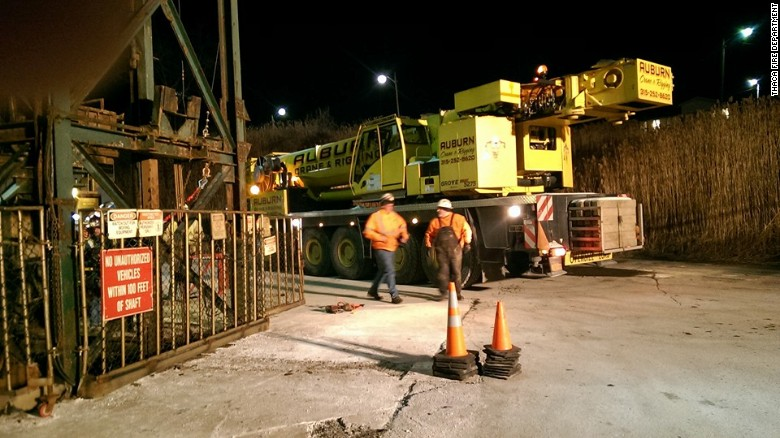 A crane arrives at the Cargill rock salt mine to help rescue 17 trapped miners.