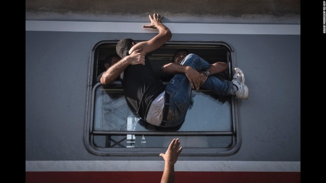 Refugees in Tovarnik, Hungary, attempt to board a train headed to Zagreb, Croatia, on September 18.