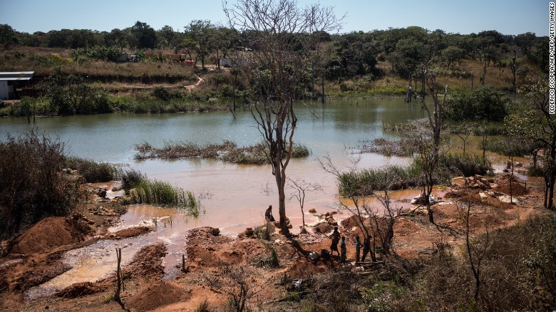 Workers extracting cobalt from a lake in Katanga province, DR Congo.