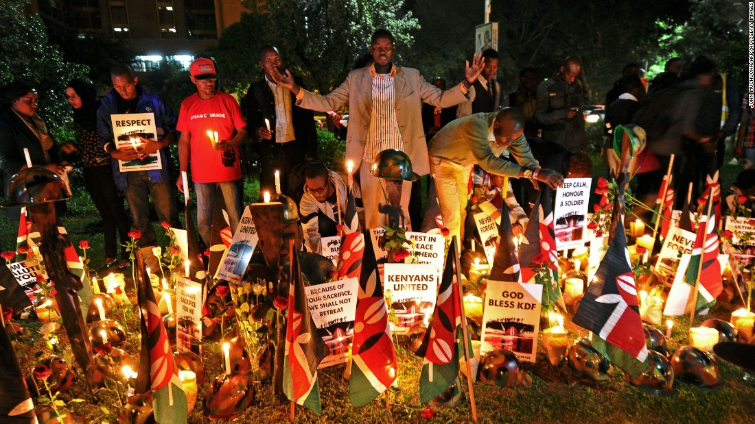 Kenyans in Nairobi pray at a candlelit vigil in honor of Kenyan soldiers on January 21, 2016.