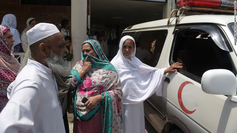 Pakistani relatives stand alongside an ambulance carrying Maria Abbasi, June 1, 2016.