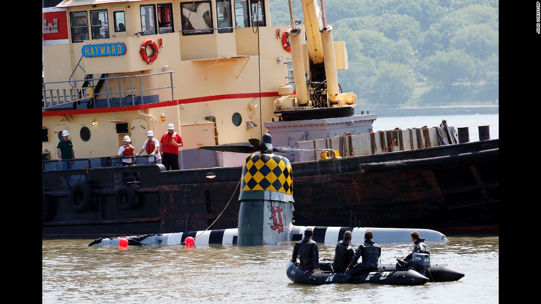 "A vintage World War II plane is pulled out of the Hudson River on Saturday, May 28, a day after <a href=""http://www.cnn.com/2016/05/27/us/wwii-plane-crash-hudson-river/"" target=""_blank"">it crashed</a> in North Bergen, New Jersey. The body of a 56-year-old man, presumed to be the pilot, was recovered in the river near the downed plane, the New York Police Department said."