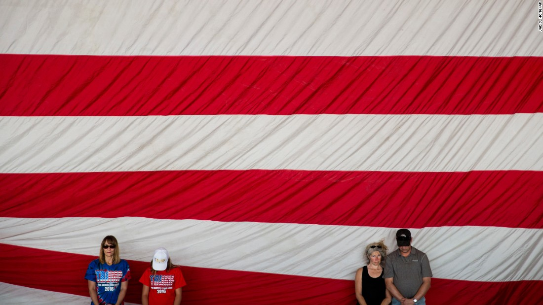 Donald Trump supporters pray before the Republican presidential candidate arrived at a rally in Sacramento, California, on Wednesday, June 1.