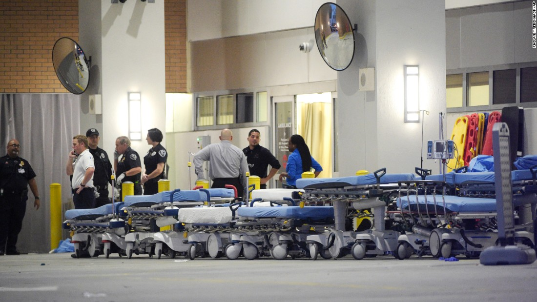 Medical personnel wait with stretchers at the Orlando Regional Medical Center.