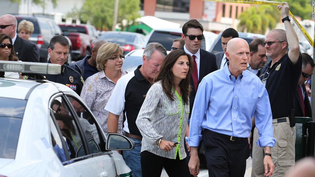 Florida Gov. Rick Scott arrives at the scene.