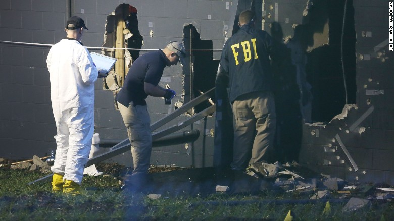 FBI agents investigate near the damaged rear wall of the Pulse Nightclub where Omar Mateen allegedly killed at least 50 people on June 12, 2016 in Orlando, Florida. The mass shooting killed at least 50 people and injuring 53 others in what is the deadliest mass shooting in the country's history.