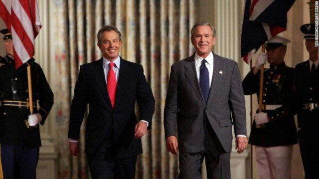 US President George W. Bush and British Prime Minister Tony Blair walk together on their way to a press briefing on June 7, 2005 in the East Room of the White House in Washington, DC.