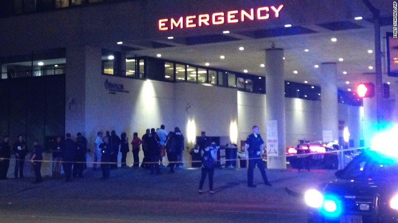 Police and others gather at the emergency entrance to Baylor University Medical Center in Dallas, where several police officers were taken after the shootings.