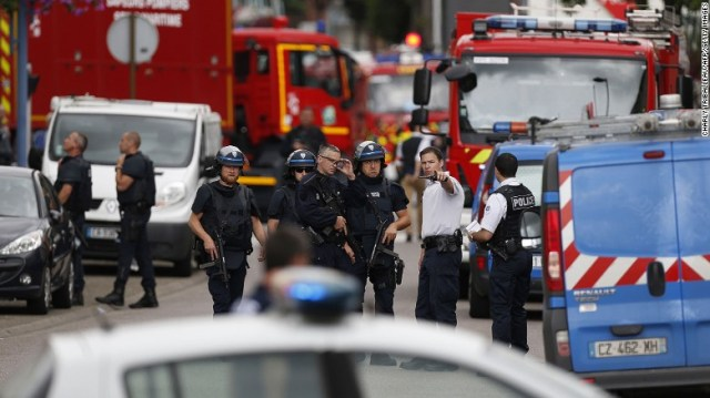 Police and firemen arrive at the scene of the attack.