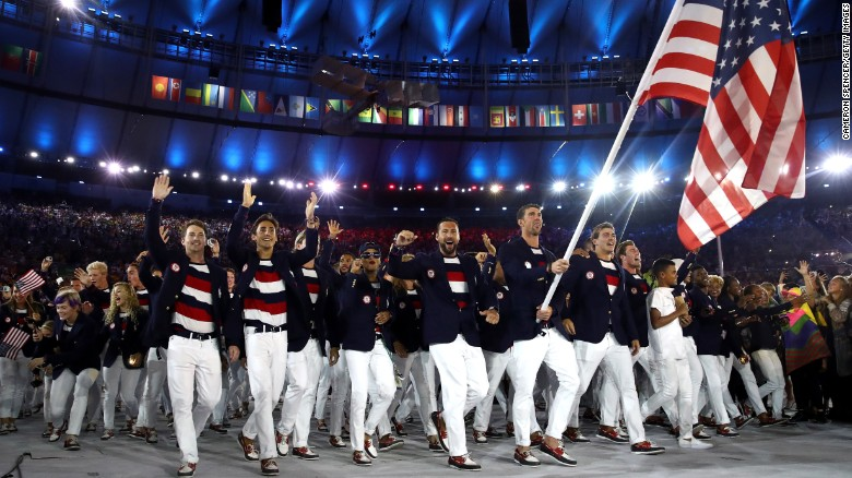 Michael Phelps of the United States carries the flag during the Opening Ceremony of the Rio 2016 Olympic Games at Maracana Stadium on August 5, 2016 in Rio de Janeiro, Brazil.