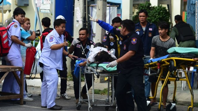 Rescue workers tend to an injured victim after a bomb exploded in Hua Hin on August 12, 2016. At least eight explosions hit separate areas of Thailand on Thursday night and Friday morning, local time.