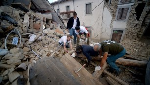 Residents search for victims in Amatrice, one of the hardest-hit towns.