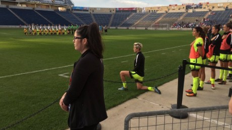 Image result for megan rapinoe takes a knee
