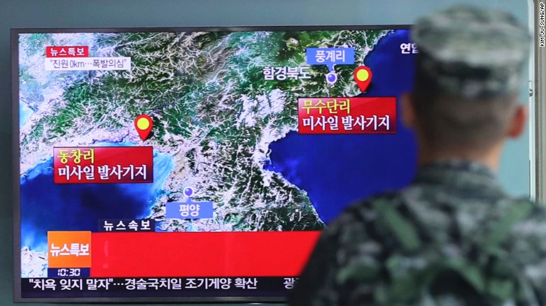 """A South Korean marine watches a TV screen reporting about North Korea's possible nuclear test at the Seoul Railway Station in Seoul, South Korea, Friday, Sep. 9, 2016. South Korea's Yonhap news agency said Seoul believes North Korea conducted its fifth nuclear test explosion on Friday. The letters on the screen read: """"Explosion suspect."""" (Kim Ju-sung/Yonhap via AP)"""