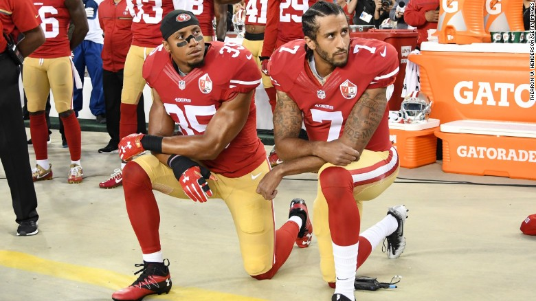 Colin Kaepernick (right) and Eric Reid of the San Francisco 49ers kneel in protest during the national anthem on September 12, 2016, in Santa Clara, California.