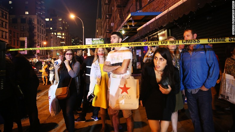 NEW YORK, NY - SEPTEMBER 17:  People stand behind police lines as firefighters, emergency workers and police gather at the scene of an explosion in Manhattan on September 17, 2016 in New York City. The evening explosion at 23rd street in the popular Chelsea neighborhood injured over a dozen people and is being investigated.  (Photo by Spencer Platt/Getty Images)