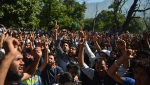 Kashmiri mourners shout slogans at a funeral in Srinagar on September 17, 2016.