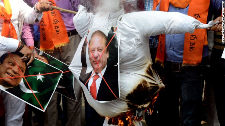 Indian activists burn an effigy of Pakistan's Prime Minister Nawaz Sharif during a protest against Pakistan, in New Delhi  September 19, 2016.