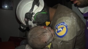 Rescuer weeps after saving Syrian baby