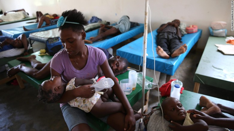 People sick with cholera receive medical assistance at Saint Antoine Hospital in Jeremie, Haiti, on Monday, October 10. Days after the storm smashed into southwestern Haiti, some communities along the southern coast have yet to receive any assistance, leaving residents who have lost their homes and virtually all their belongings struggling to find shelter and potable water.