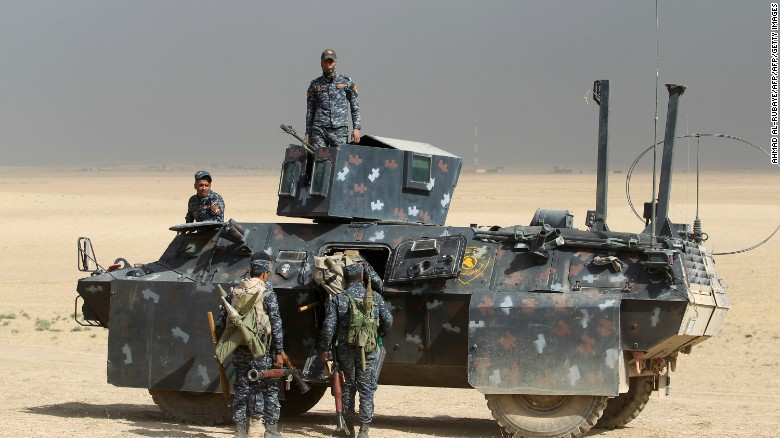 Iraqi forces hold a position on October 17, 2016 in the area of al-Shurah, some 45 kms south of Mosul.