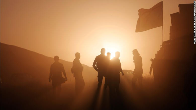 Kurdish Peshmerga forces take positions as they start to move toward the Imam Reza and Tizxirab villages of Bashiqa district as part of the operation to retake Mosul, Iraq, on October 23.
