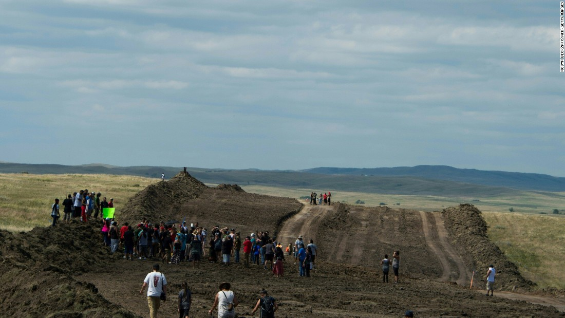 Native American protestors and supporters walk along land being prepared for the Dakota Access Pipeline.