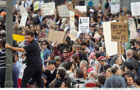 Protesters affiliated with Occupy Wall Street moved uptown on Tuesday to demonstrate outside of some of New York's richest residents' homes.