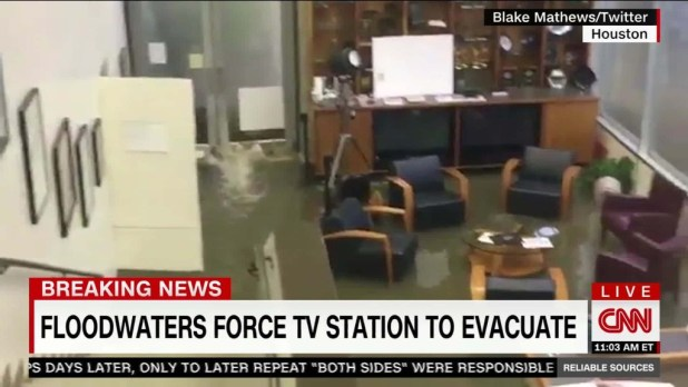 Houston TV station rushed to higher ground as floodwater rises