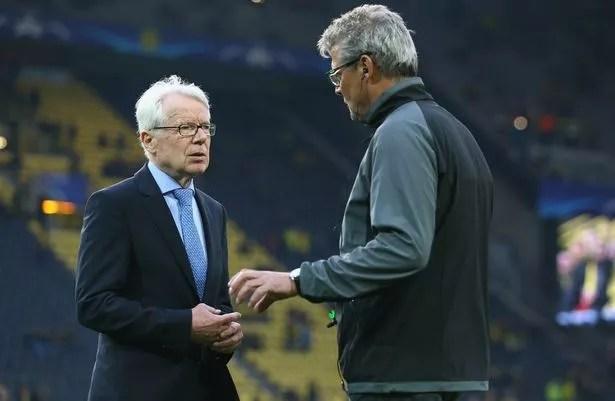 Reinhard Rauball of Dortmund and stadium speaker Norbert Dickel of Dortmund look concerned