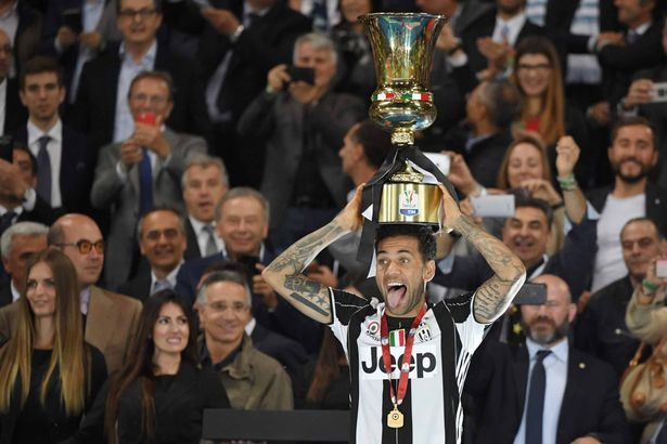 Dani Alves with the latest of his many, MANY trophies