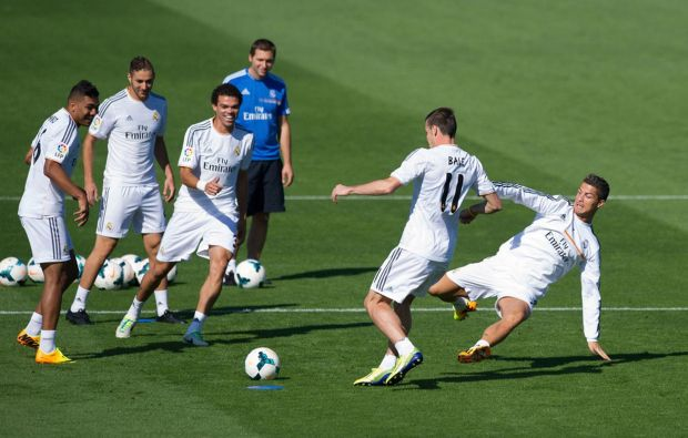 Real Madrid's new signing Gareth Bale is tackled by Cristiano Ronaldo