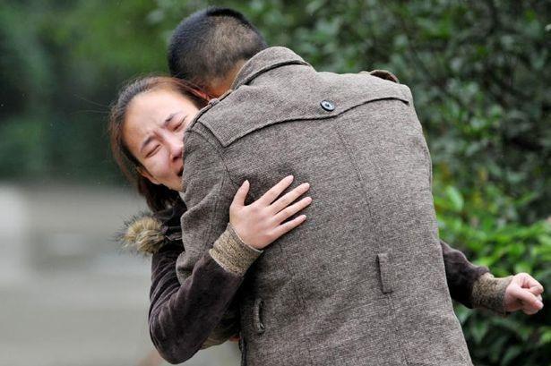 Agony: Heartbroken parents of 10-year-old Chinese boy Jun Jun