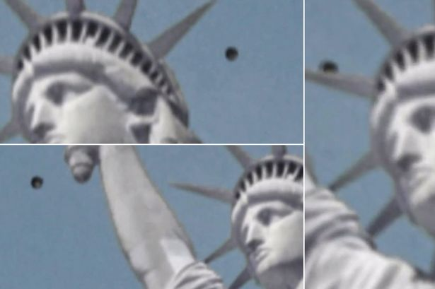 An object floats past the Statue Of Liberty in New York