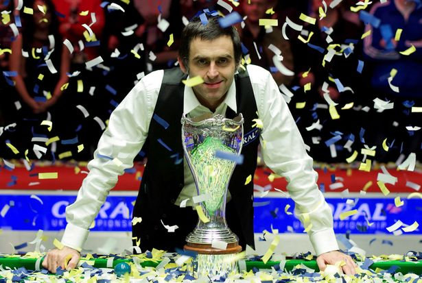 Ronnie O'Sullivan poses with his trophy after defeating Judd Trump in the 2014 UK Championship