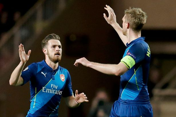 Aaron Ramsey celebrates his goal with Per Mertesacker