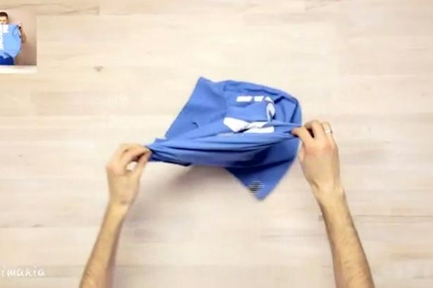 A GIF shows you how to easily fold a tshirt