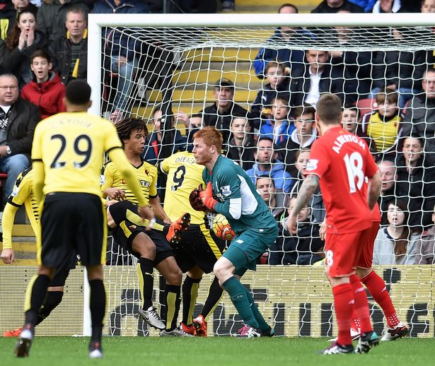 Troy Deeney of Watford scores the opening goal